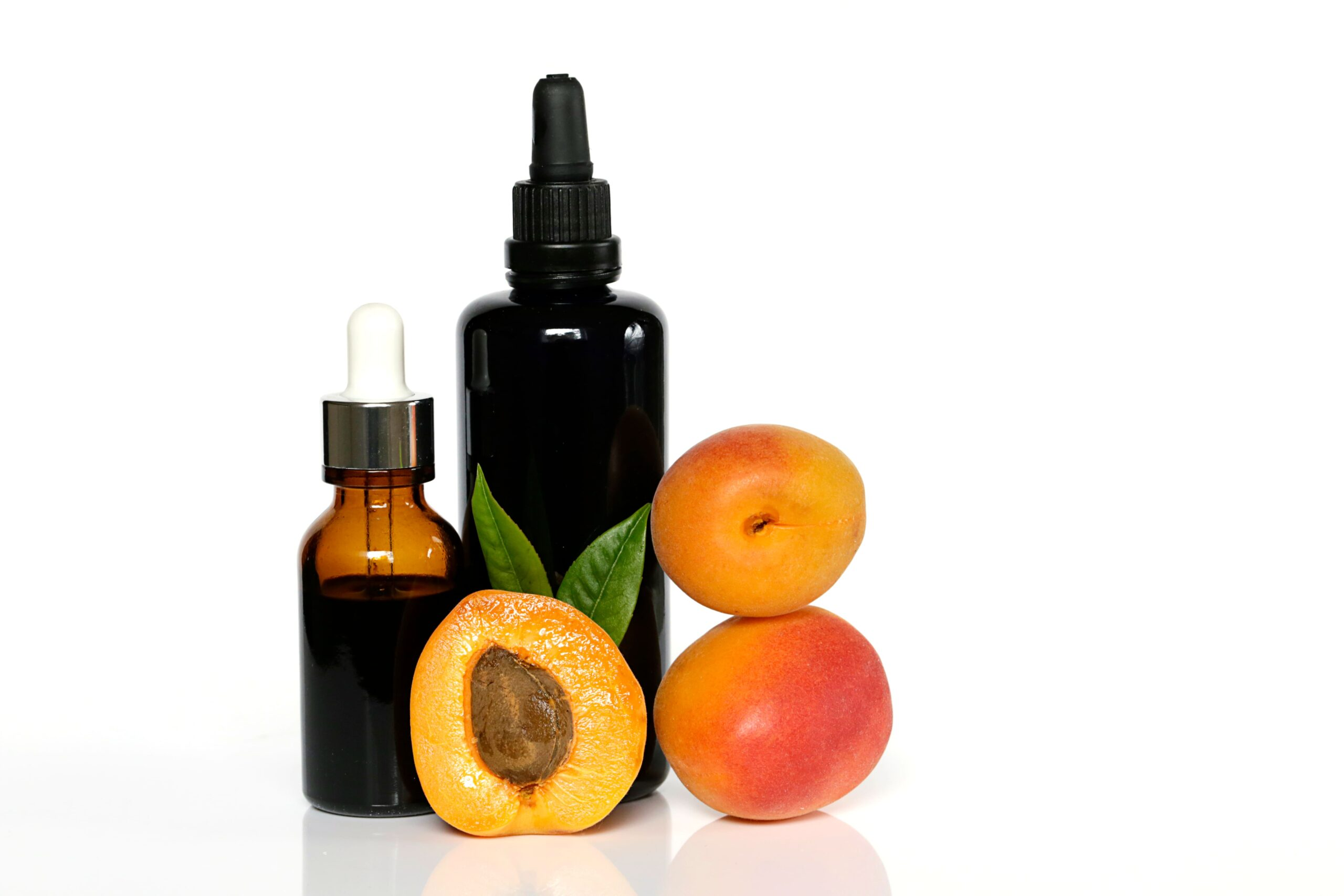 apricot oil apricot oil in glass bottle and ripe apricots 1 scaled
