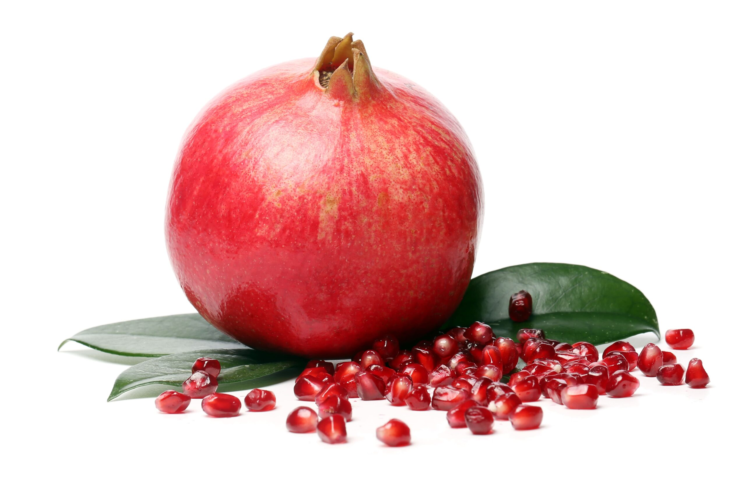 exotic and delicious pomegranate on white background 1 scaled