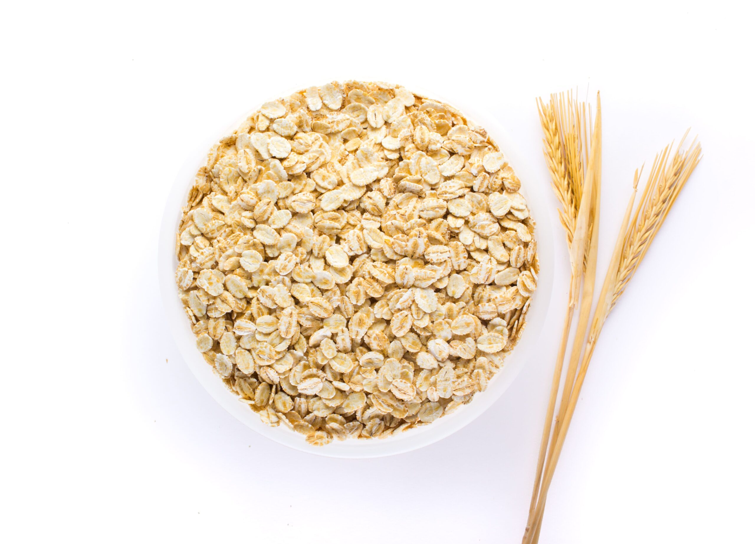 oat flakes uncooked oats in bowl concept of healthy eating vegan food healthy food breakfast 1 1 scaled
